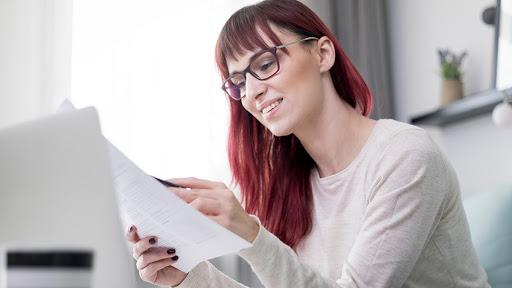 woman reading invoice
